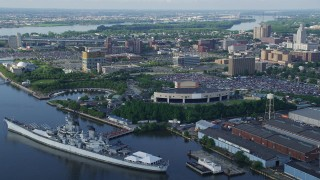 AX79_089 - 5K stock footage aerial video tilting down on USS New Jersey by BB&T Pavilion in Camden, New Jersey
