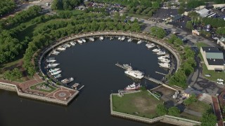 AX79_090 - 5K stock footage aerial video of boats docked at Wiggins Marina, Camden, New Jersey