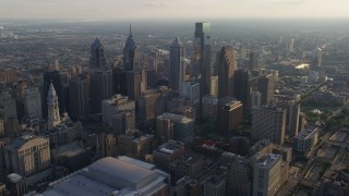 AX80_007 - 5K stock footage aerial video approaching Downtown Philadelphia's City Hall and tall skyscrapers, Pennsylvania, Sunset