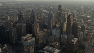 AX80_007E - 5K stock footage aerial video approaching Downtown Philadelphia's City Hall and tall skyscrapers, Pennsylvania, Sunset