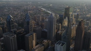 AX80_008 - 5K stock footage aerial video flying over BNY Mellon Center to approach the Schuylkill River, Downtown Philadelphia, Pennsylvania, Sunset