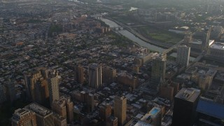 AX80_009 - 5K stock footage aerial video flying over neighborhoods by the Schuylkill River to approach power plant, South Philadelphia, Pennsylvania, Sunset