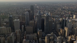 AX80_011E - 5K stock footage aerial video of Downtown Philadelphia skyscrapers, city buildings and urban neighborhoods in Pennsylvania, Sunset