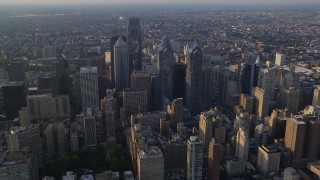 AX80_012 - 5K stock footage aerial video approaching One and Two Liberty Place and skyscrapers in Downtown Philadelphia, Pennsylvania, Sunset