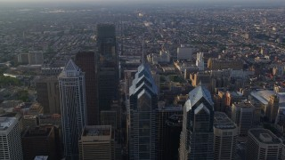 AX80_013 - 5K stock footage aerial video flying over One and Two Liberty Place, BNY Mellon Center, Comcast Center, Downtown Philadelphia, Pennsylvania, sunset