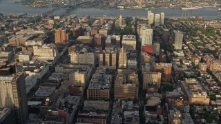 AX80_019 - 5K stock footage aerial video of office and apartment buildings in Downtown Philadelphia, Pennsylvania, Sunset