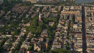 AX80_020 - 5K stock footage aerial video of St Peter's Episcopal Church in an urban neighborhood, Philadelphia, Philadelphia, Sunset
