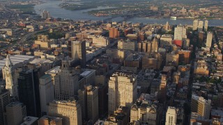 AX80_023 - 5K stock footage aerial video flying by office and apartment buildings, reveal City Hall, Downtown Philadelphia, Pennsylvania, Sunset