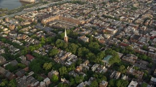 AX80_028 - 5K stock footage aerial video approaching St Peter's Episcopal Church in an urban neighborhood at sunset, Philadelphia, Pennsylvania