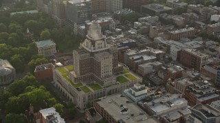AX80_029 - 5K stock footage aerial video orbiting the United States Customs House at sunset in Philadelphia, Pennsylvania
