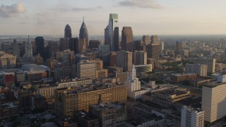 AX80_049 - 5K stock footage aerial video of Downtown Philadelphia's high-rises and skyscrapers, Pennsylvania, Sunset
