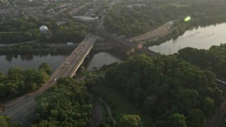 AX80_053 - 5K stock footage aerial video approaching Girard Bridge spanning the Schuylkill River in Philadelphia, Pennsylvania, Sunset