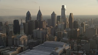 AX80_060 - 5K stock footage aerial video of skyscrapers in Downtown Philadelphia, Pennsylvania at sunset