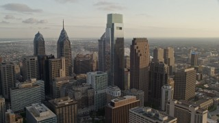 AX80_061 - 5K stock footage aerial video flying by Downtown Philadelphia skyscrapers, Pennsylvania, Sunset