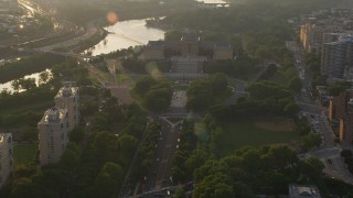 AX80_062 - 5K stock footage aerial video approaching the fountain in The Oval park and Philadelphia Museum of Art, Pennsylvania Sunset