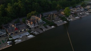 AX80_066 - 5K stock footage aerial video tilting and flyby Boathouse Row, Philadelphia, Pennsylvania, Sunset