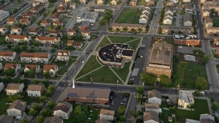 AX80_070 - 5K stock footage aerial video of a community center and church in North Philadelphia, Pennsylvania Sunset