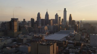 AX80_079 - 5K stock footage aerial video of Downtown Philadelphia skyscrapers and convention center, Pennsylvania, Sunset
