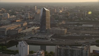AX80_083 - 5K stock footage aerial video approaching Cira Centre in West Philadelphia, Pennsylvania, Sunset