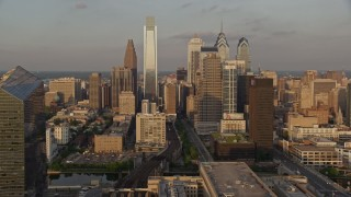 AX80_086 - 5K aerial stock footage video of Downtown Philadelphia skyscrapers, Pennsylvania, Sunset