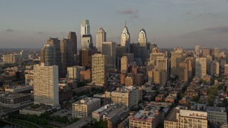 AX80_087 - 5K stock footage aerial video of skyscrapers and high-rises in Downtown Philadelphia, Pennsylvania, Sunset