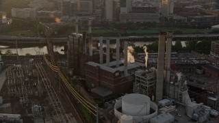 AX80_088 - 5K stock footage aerial video of Veolia Energy power plant in South Philadelphia, Pennsylvania, Sunset
