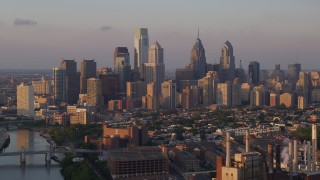 AX80_090 - 5K stock footage aerial video of Downtown Philadelphia skyline seen from Schuylkill River, Pennsylvania, Sunset
