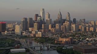 AX80_090E - 5K stock footage aerial video of Downtown Philadelphia skyline seen from Schuylkill River, Pennsylvania, Sunset