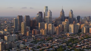 AX80_093 - 5K stock footage aerial video approaching and flying by Downtown Philadelphia skyscrapers in Pennsylvania at Sunset