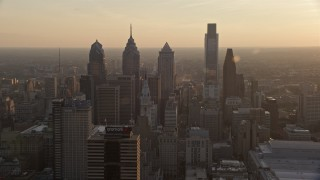 AX80_101 - 5K stock footage aerial video approaching City Hall and Downtown Philadelphia skyscrapers, Pennsylvania, Sunset