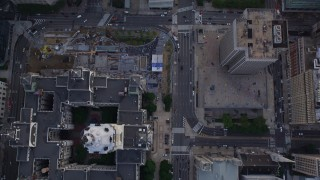 AX80_102 - 5K stock footage aerial video of bird's eye view of Filbert Street and City Hall, Philadelphia, Pennsylvania, Sunset