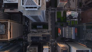 AX80_103 - 5K stock footage aerial video of a bird's eye view of JFK Boulevard, JFK Plaza, city buildings in Downtown Philadelphia, Pennsylvania, Sunset