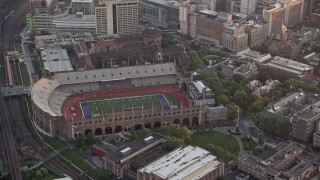 AX80_105 - 5K stock footage aerial video of Franklin Field at University of Pennsylvania, West Philadelphia, Sunset