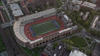 AX80_106 - 5K stock footage aerial video of a bird's eye view of Franklin Field at University of Pennsylvania, West Philadelphia, Sunset