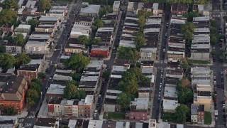 AX80_107 - 5K stock footage aerial video of row houses and city streets in South Philadelphia, Pennsylvania, Sunset