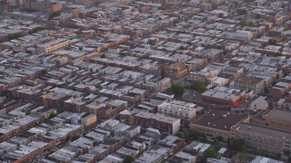AX80_109 - 5K stock footage aerial video of an urban neighborhood in South Philadelphia, Pennsylvania, Sunset