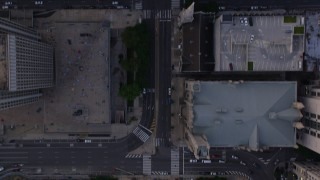 AX80_116 - 5K stock footage aerial video of a bird's eye view of Broad Street through Downtown Philadelphia, Pennsylvania, Sunset