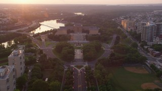 AX80_120 - 5K stock footage aerial video tilting from Logan Square to reveal Philadelphia Museum of Art, Pennsylvania, Sunset