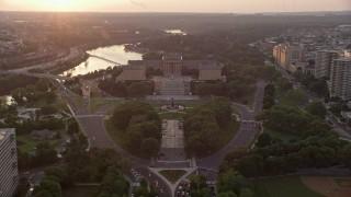 AX80_120E - 5K stock footage aerial video tilting from Logan Square to reveal Philadelphia Museum of Art, Pennsylvania, Sunset