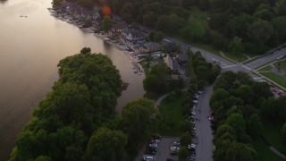AX80_122 - 5K stock footage aerial video tilting from fountain to reveal Boathouse Row on Schuylkill River, Philadelphia, Pennsylvania Sunset