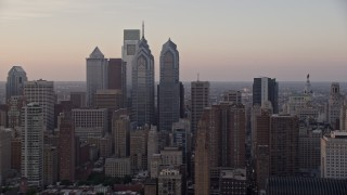 AX80_129 - 5K stock footage aerial video flying by Downtown Philadelphia skyscrapers and City Hall, Pennsylvania, Sunset