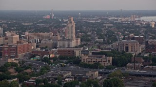 AX80_135 - 5K stock footage aerial video of Camden County City Hall and US District Court in Camden, New Jersey, Sunset