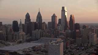 AX80_142 - 5K stock footage aerial video approaching tall skyscrapers in Downtown Philadelphia, Pennsylvania, Sunset
