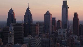 AX80_146 - 5K stock footage aerial video of tall Downtown Philadelphia skyscrapers and City Hall, Pennsylvania, Sunset