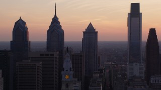 AX80_147 - 5K stock footage aerial video of Downtown Philadelphia skyscrapers and William Penn statue on City Hall, Pennsylvania, Sunset