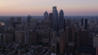 AX80_150 - 5K stock footage aerial video flying by Downtown Philadelphia skyscrapers, Pennsylvania, Sunset