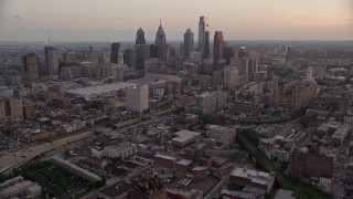 AX80_155 - 5K stock footage aerial video of Downtown Philadelphia skyline, Pennsylvania Convention Center, and I-676, Pennsylvania, Sunset