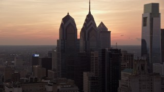 AX80_157 - 5K stock footage aerial video of One and Two Liberty Place in Downtown Philadelphia, Pennsylvania, Sunset