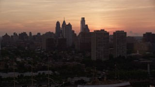 AX80_160 - 5K stock footage aerial video of the skyline of Downtown Philadelphia, Pennsylvania at Sunset