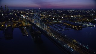 AX81_004 - 5K stock footage aerial video flying by Benjamin Franklin Bridge, reveal Downtown Philadelphia skyline, Pennsylvania, Night